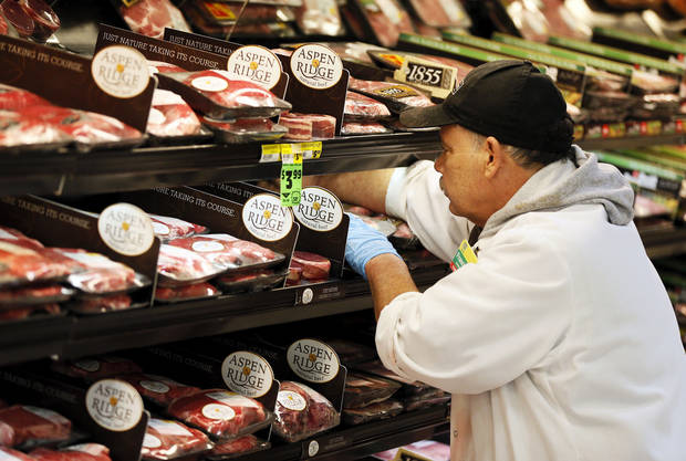 Francisco Ramirez, assistant meat manager, straightens up the case in the meat department at Buy For Less, 3501 NW Expressway, in Oklahoma City, Wednesday, May 29, 2013. Photo by Nate Billings, The Oklahoman