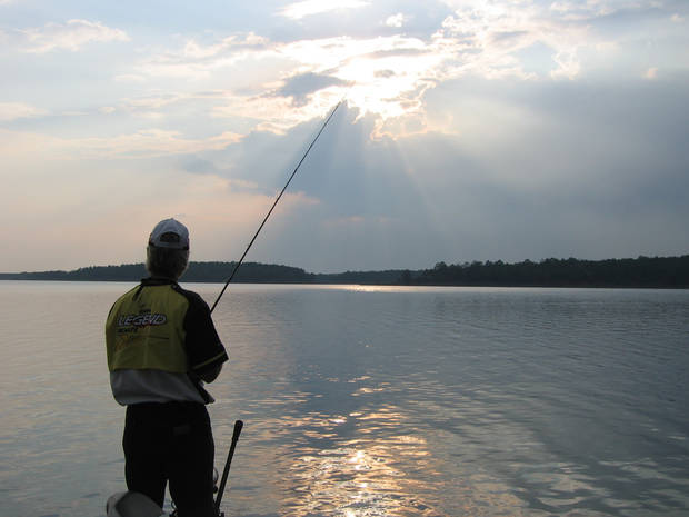 FISH / FISHING / MCGEE CREEK LAKE: A late-afternoon storm that passed through McGee Creek made for a scenic evening of fishing Wednesday, Aug. 29, 2007, on this 3,800-acre impoundment. Pictured fishing is fishing guide Chuck Justice. - BY ED GODFREY, THE OKLAHOMAN