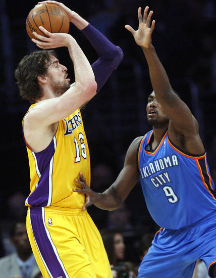 Los Angeles' Pau Gasol (16) shoots over Oklahoma City's Serge Ibaka (9) during Game 4 in the second round of the NBA basketball playoffs between the L.A. Lakers and the Oklahoma City Thunder at the Staples Center in Los Angeles, Saturday, May 19, 2012. Photo by Nate Billings, The Oklahoman