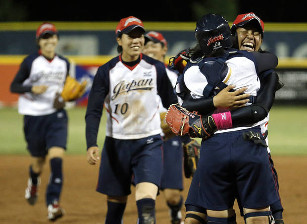 Japan celebrates their win over the USA in the World Cup of Softball tournament championship game, Sunday, July 14, 2013, at the ASA Hall of Fame Stadium in Oklahoma City. Photo by Sarah Phipps, The Oklahoman