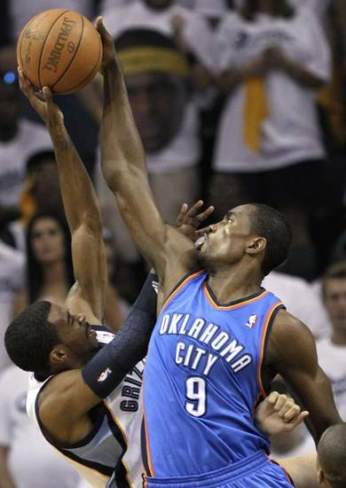 Oklahoma City Thunder forward Serge Ibaka (9) blocks a shot by Memphis Grizzlies guard Mike Conley, left, during the first half of Game 3 of a second-round NBA basketball series on Saturday, May 7, 2011, in Memphis, Tenn. (AP Photo/Lance Murphey) ORG XMIT: TNMH104