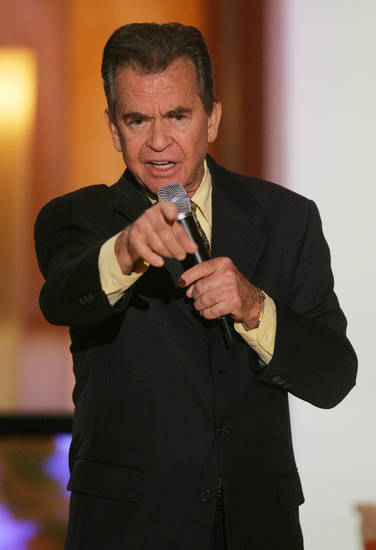 Dick Clark, executive producer of the sixth annual Family Television Awards, speaks to attendees before the taping of the show in Beverly Hills, Calif., on Wednesday, Dec. 1, 2004. (AP Photo/Danny Moloshok)