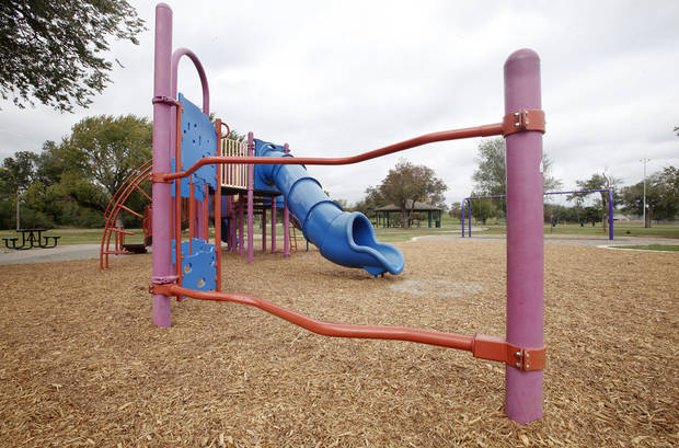 The playgound at Washington Park, 400 N High Ave., is one of seven at Oklahoma City parks that officials have temporarily closed due to a potential safety risk involving foreign material in the wood chip playing surface. <strong>PAUL B. SOUTHERLAND - The Oklahoman</strong>