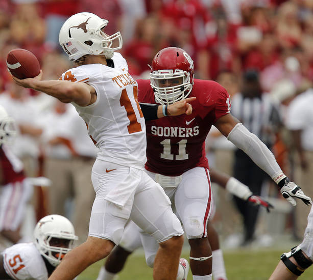 OU's R.J. Washington (11) puts pressure on UT's David Ash (14) during the Red River Rivalry college football game between the University of Oklahoma (OU) and the University of Texas (UT) at the Cotton Bowl in Dallas, Saturday, Oct. 13, 2012. Photo by Chris Landsberger, The Oklahoman