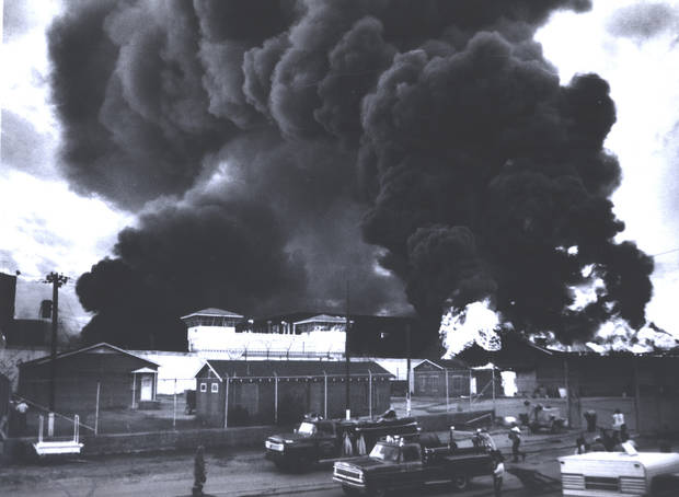 In this July 1973 photo provided by the Oklahoma Department of Corrections, a fire burns inside the gate at the Oklahoma State Penitentiary at McAlester in McAlester, Okla., during one of the most destructive prison riots in American history. The prison erupted into violence on July 27, 1973, the result of overcrowding, inadequate supervision, poor health care and a culture of violence within the prison walls. The prison was eventually rebuilt as a maximum security prison. (AP Photo/Oklahoma Department of Corrections) ORG XMIT: OKSO213