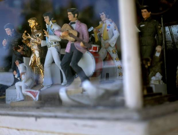 A collection of Elvis Presley decorations on Tuesday, Aug. 9, 2011. Severe storms on Monday night damaged buildings in Perry. Photo by John Clanton, The Oklahoman