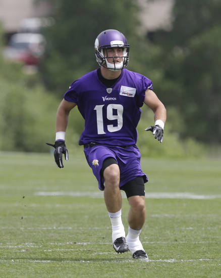 FILE - In this June 20, 2013 file photo, Minnesota Vikings wide receiver Adam Thielen runs during passing drills at the Vikings' NFL football mini-camp in Eden Prairie, Minn. Thielen is among the small-college rookies in training camps around the NFL this year with decent chances to make the team. (AP Photo/Jim Mone, File)