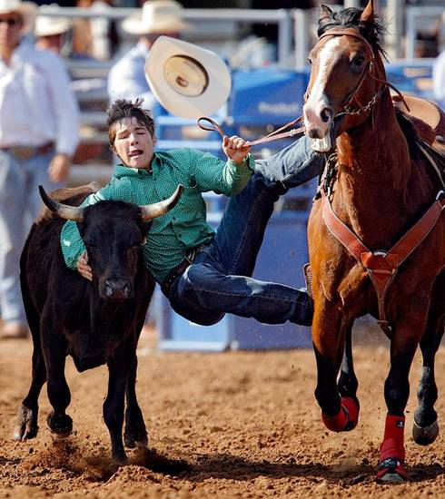 Austin Vincent, of Des Moines, New Mexico, jumps on his steer in the steer wrestling event during the International Finals Youth Rodeo at the Shawnee Expo Center on Friday, July, 17, 2009, in Shawnee, Okla.  Photo by Chris Landsberger, The Oklahoman