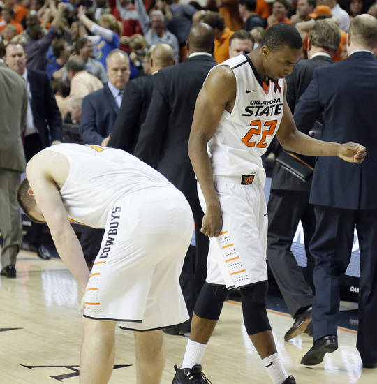 Oklahoma State 's Phil Forte (13) and Markel Brown (22) reacts after the 68-67 double overtime loss to Kansas during the college basketball game between the Oklahoma State University Cowboys (OSU) and the University of Kanas Jayhawks (KU) at Gallagher-Iba Arena on Wednesday, Feb. 20, 2013, in Stillwater, Okla. Photo by Chris Landsberger, The Oklahoman