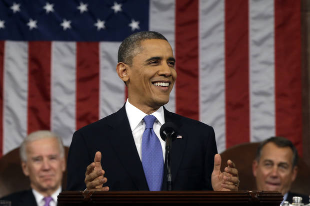 President Barack Obama, flanked by Vice President John Biden and House Speaker John Boehner smiles as he gives his State of the Union address during a joint session of Congress on Capitol Hill in Washington, Tuesday Feb. 12, 2013. (AP Photo/Charles Dharapak, Pool) ORG XMIT: CAP521