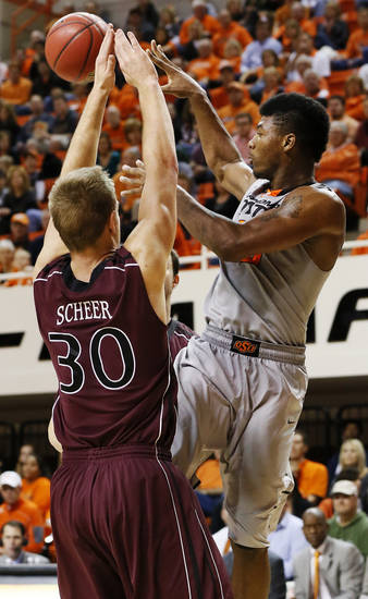 OSU's Marcus Smart (33) passes the ball away from Nathan Scheer (30) of Missouri State during a men's college basketball between Oklahoma State University and Missouri State at Gallagher-Iba Arena in Stillwater, Okla., Saturday, Dec. 8, 2012. OSU won, 62-42. Photo by Nate Billings, The Oklahoman