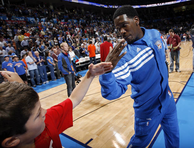 Oklahoma City's Royal Ivey (7) greets a fan before the NBA basketball game between the Oklahoma City Thunder and the Sacramento Kings at Chesapeake Energy Arena in Oklahoma City, Friday, April 13, 2012. Oklahoma City won, 115-89. Photo by Nate Billings, The Oklahoman