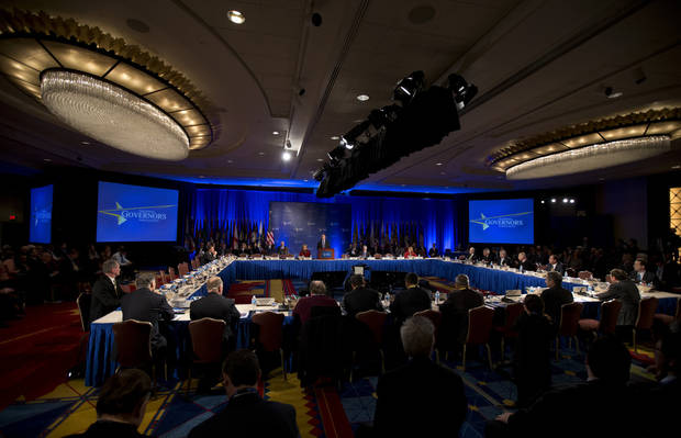 "National Governors Association 2013 Winter Meeting opening session is presided by Chairman Gov. Jack Markell of Delaware, standing at podium, in Washington, Saturday, Feb. 23, 2013. States are grappling with a wave of uncertainty from Washington and facing the potential of spending cuts from the so-called ""sequester"" as they try to climb out of tough economic conditions. (AP Photo/Manuel Balce Ceneta)"