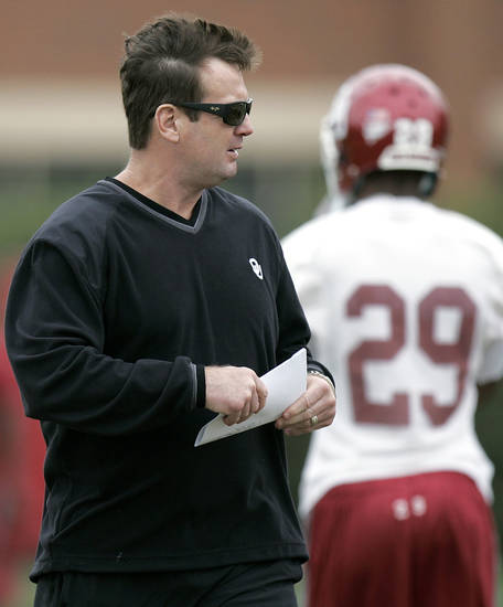 Head Coach Bob Stoops watches his team during the first day of spring practice at the University of Oklahoma in Norman on Monday, March 21, 2011. Photo by John Clanton, The Oklahoman