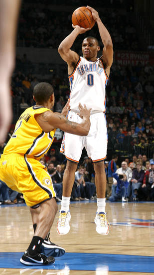 Oklahoma City's Russell Westbrook (0) shoots over Indian's Earl Watson during the basketball game between the Oklahoma City Thunder and the Indiana Pacers, Saturday, Jan. 9, 2010 at the Ford Center in Oklahoma CIty. Photo by Sarah Phipps, The Oklahoman