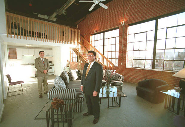 Developers Mark Ruffin, left, and Nick Preftakes, Precor Realty Advisors Inc. stand in a loft apartment complex believed to be the first in the city which opened at 113 NW 13 in a former auto dealership garage.
