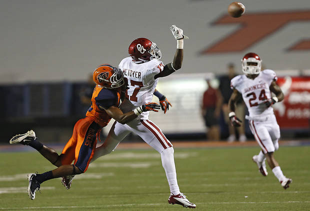 Oklahoma Sooners wide receiver Trey Metoyer (17) misses the pass while defended on by UTEP's Drew Thomas (10) during the college football game between the University of Oklahoma Sooners (OU) and the University of Texas El Paso Miners (UTEP) at Sun Bowl Stadium on Saturday, Sept. 1, 2012, in El Paso, Tex.  Photo by Chris Landsberger, The Oklahoman