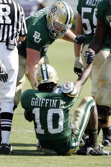 Robert Griffin is helped to his feet after a sack in the second half during the college football game between Oklahoma (OU) and Baylor University at Floyd Casey Stadium in Waco, Texas, Saturday, October 4, 2008.   BY STEVE SISNEY, THE OKLAHOMAN