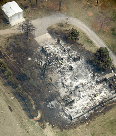 A burned down house near Lake Stanley Draper, Friday, April 10, 2009. Photo by Bryan Terry, The Oklahoman