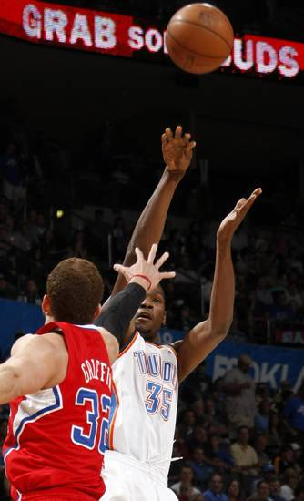 Oklahoma City&#039;s Kevin Durant (35) shoots the ball as Los Angeles Clippers&#039; Blake Griffin (32) defends during the NBA basketball game between the Oklahoma City Thunder and the Los Angeles at the Oklahoma City Arena, Wednesday, April 6, 2011. Photo by Bryan Terry, The Oklahoman