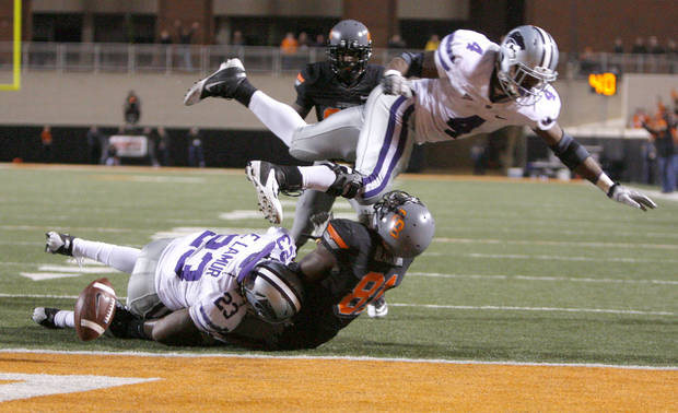 Oklahoma State's Justin Blackmon (81) fumbles the ball as Kansas State's Emmanuel Lamur (23) and Arthur Brown (4) tackle him during a college football game between the Oklahoma State University Cowboys (OSU) and the Kansas State University Wildcats (KSU) at Boone Pickens Stadium in Stillwater, Okla., Saturday, Nov. 5, 2011.  Photo by Sarah Phipps, The Oklahoman