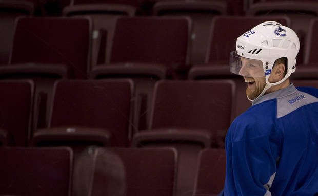 Vancouver  Canucks' Daniel Sedin, of Sweden,  laughs during NHL hockey training camp at Rogers Arena in Vancouver, British Columbia, Tuesday, Jan. , 15, 2013. (AP Photo/The Canadian Press, Jonathan Hayward)
