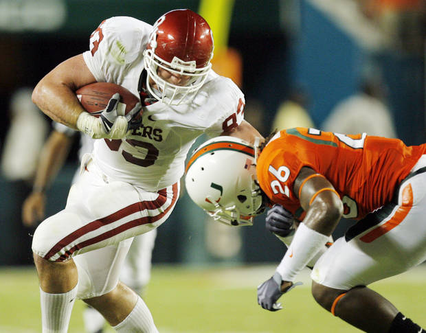 OU&#039;s Brody Eldridge (83) is tackled by Ray Ray Armstrong (26) after making a catch during the college football game between the University of Oklahoma (OU) Sooners and the University of Miami (UM) Hurricanes at Land Shark Stadium in Miami Gardens, Florida, Saturday, October 3, 2009. Photo by Nate Billings, The Oklahoman ORG XMIT: KOD