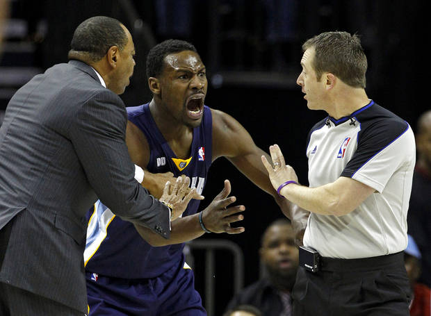 Memphis Grizzlies head coach Lionel Hollins, left, tries to control Tony Allen, center, as he is charged with a technical foul by referee Pat Fraher, right, during the first half of an NBA basketball game against the Charlotte Bobcats, Saturday, Nov. 17, 2012, in Charlotte, N.C. (AP Photo/Chuck Burton)