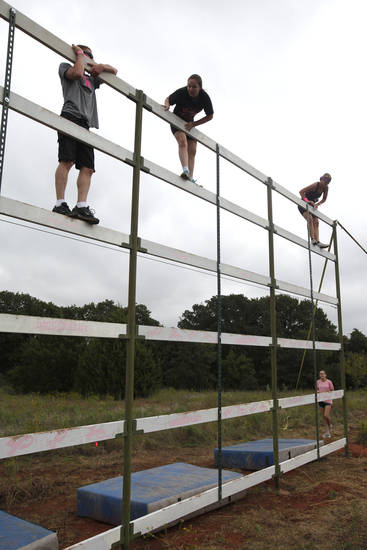 Runners climb over a 15 foot tower during the Juggernaut mud run at Mitch Park, in Edmond, OK, Saturday, September 29, 2012. The Juggernaut is part of a national mud run series to raise money for Susan G. Komen for the Cure. By Paul Hellstern, The Oklahoman