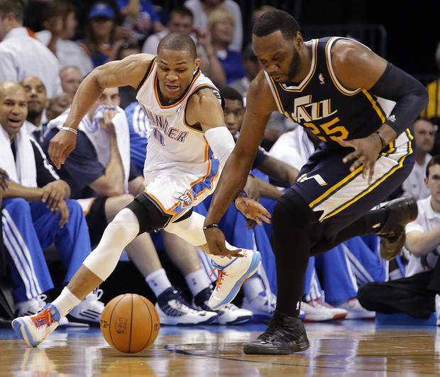 Oklahoma City Thunder's Russell Westbrook (0) and Utah Jazz's Al Jefferson (25) chase down a loose ball during the NBA basketball game between the Oklahoma City Thunder and the Utah Jazz at Chesapeake Energy Arena on Wednesday, March 13, 2013, in Oklahoma City, Okla. Photo by Chris Landsberger, The Oklahoman