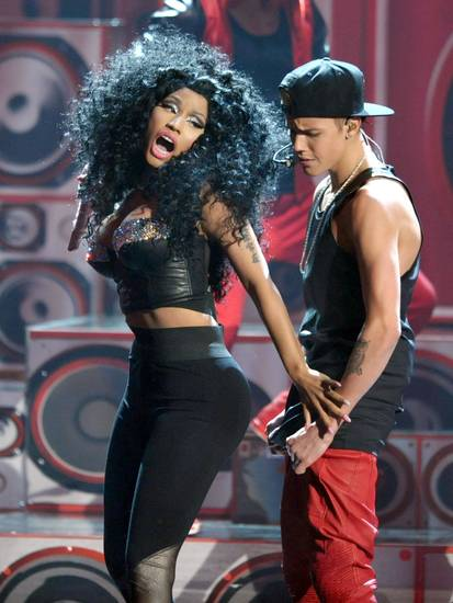 Justin Bieber, right, and Nicki Minaj perform at the 40th Anniversary American Music Awards on Sunday, Nov. 18, 2012, in Los Angeles. (Photo by John Shearer/Invision/AP)