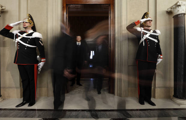 Senators leave after a meeting with Italian President Giorgio Napolitano at Rome's Quirinale presidential palace Saturday Dec. 22, 2012. Italy's president is meeting with political leaders to set the stage for general elections early next year as Premier Mario Monti weighs whether to run for office after having handed in his resignation. Monti, appointed 13 months ago to steer Italy away from a Greek-style debt crisis, stepped down Friday after ex-Premier Silvio Berlusconi's party yanked its support for his technical government. (AP Photo/Alessandra Tarantino)