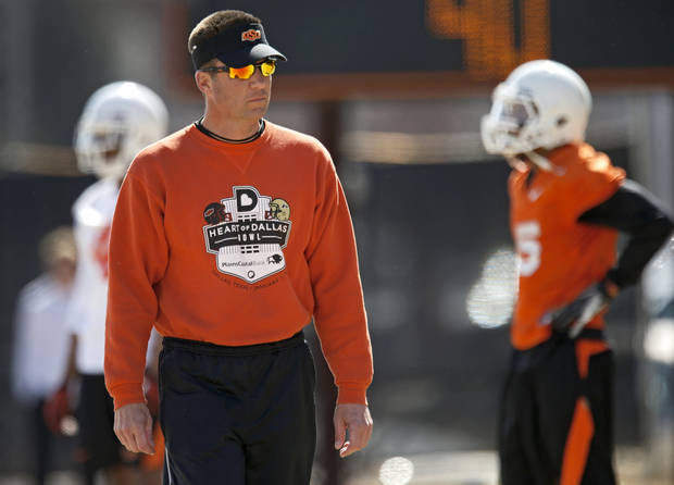 OKLAHOMA STATE UNIVERSITY / OSU / COLLEGE FOOTBALL: Oklahoma State coach Mike Gundy watches during an OSU spring football practice in Stillwater, Okla., Wednesday, March 13, 2013. Photo by Bryan Terry, The Oklahoman