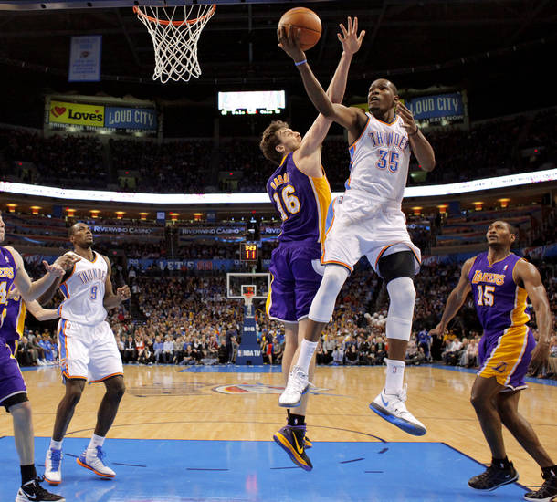 Oklahoma City's Kevin Durant (35) goes past Los Angeles' Pau Gasol (16) during an NBA basketball game between the Oklahoma City Thunder and the Los Angeles Lakers at Chesapeake Energy Arena in Oklahoma City, Thursday, Feb. 23, 2012.  Oklahoma City won 100-85. Photo by Bryan Terry, The Oklahoman