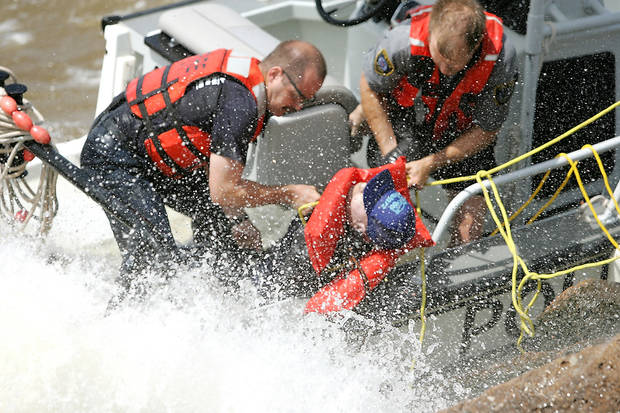 THIRD PLACE, SPOT NEWS PHOTO: Rescuers battle high winds to recover a drowning victim at Lake Hefner in Oklahoma City, Okla. June 5 , 2008.  BY STEVE GOOCH, THE  OKLAHOMAN.