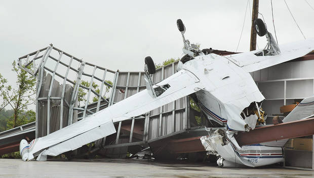 A small airplane rests on its top Tuesday afternoon after being blown out of a hangar at the Jimmie Austin Airport when a tornado touched down on the north side of Seminole on Monday night. Photo by Ann Kelley, The Oklahoman.