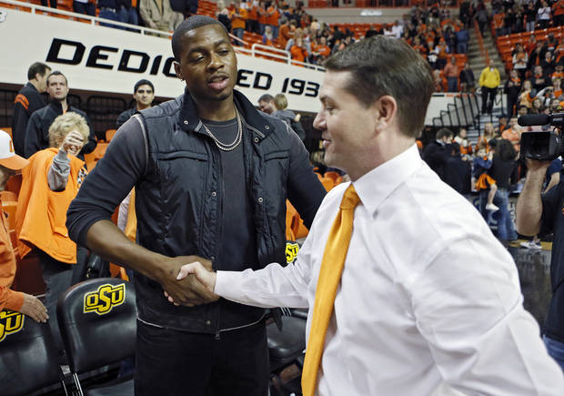 Travis Ford shakes hands with Desmond Mason during the college basketball game between the Oklahoma State University Cowboys (OSU) and the Baylor University Bears (BU) at Gallagher-Iba Arena on Wednesday, Feb. 5, 2013, in Stillwater, Okla. Photo by Chris Landsberger, The Oklahoman