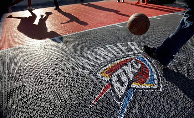 Thunder fans play basketball in the fanfest area before the start of game two of the Western Conference semifinals between the Memphis Grizzlies and the Oklahoma City Thunder in the NBA basketball playoffs at Oklahoma City Arena in Oklahoma City, Tuesday, May 3, 2011. Photo by Chris Landsberger, The Oklahoman