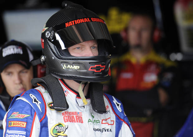 Sprint Cup Series driver Dale Earnhardt Jr. looks on during practice for the AAA 400 NASCAR Sprint Cup Series auto race, Friday, Sept. 28, 2012, in Dover, Del. (AP Photo/Nick Wass)