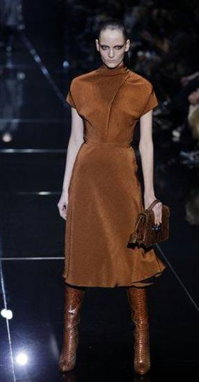 A model wears a creation for Gucci women's Fall-Winter 2013-14 collection, part of the Milan Fashion Week, unveiled in Milan, Italy, Wednesday, Feb. 20, 2013. (AP Photo/Luca Bruno)