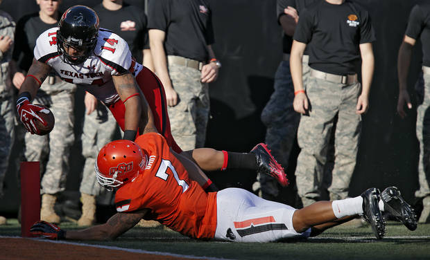 Oklahoma State's Shamiel Gary (7) stops Texas Tech's Darrin Moore (14) short of the goal line during the college football game between the Oklahoma State University Cowboys (OSU) and Texas Tech University Red Raiders (TTU) at Boone Pickens Stadium on Saturday, Nov. 17, 2012, in Stillwater, Okla.   Photo by Chris Landsberger, The Oklahoman