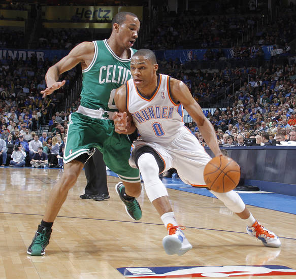 Oklahoma City Thunder point guard Russell Westbrook (0) drives past Boston Celtics shooting guard Avery Bradley (0) during the NBA basketball game between the Oklahoma City Thunder and the Boston Celtics at the Chesapeake Energy Arena on Wednesday, Feb. 22, 2012 in Oklahoma City, Okla.  Photo by Chris Landsberger, The Oklahoman