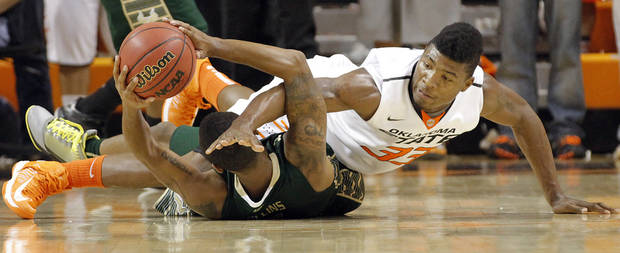 South Florida Bulls' Anthony Collins (11) and Oklahoma State 's Marcus Smart (33) battle for a loose ball during the college basketball game between Oklahoma State University (OSU) and the University of South Florida (USF) on Wednesday , Dec. 5, 2012, in Stillwater, Okla.   Photo by Chris Landsberger, The Oklahoman