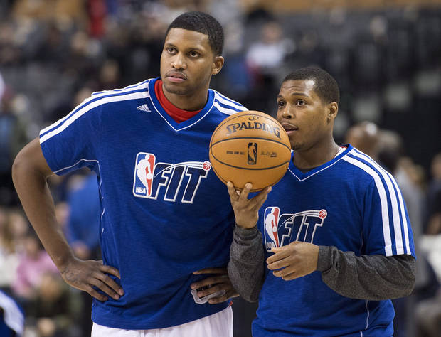 Toronto Raptors forward Rudy Gay, left, talks with guard Kyle Lowry as players warm up for an NBA basketball game between the Raptors and the Los Angeles Clippers in Toronto on Friday, Feb. 1, 2013. (AP Photo/The Canadian Press, Nathan Denette)