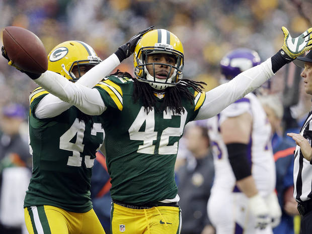 Green Bay Packers' M.D. Jennings (43) congratulates Morgan Burnett (42) after Burnett's second interception of the game during the second half of an NFL football game against the Minnesota Vikings Sunday, Dec. 2, 2012, in Green Bay, Wis. The Packers won 23-14. (AP Photo/Morry Gash)