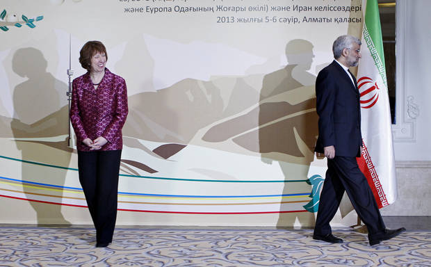 EU foreign policy chief Catherine Ashton, left, smiles, as Secretary of Iran�s Supreme National Security Council Saeed Jalili walks away, after a photo call at a start of high-level talks between world powers and Iranian officials in Almaty, Kazakhstan on Friday, April 5, 2013. (AP Photo/Shamil Zhumatov, Pool)