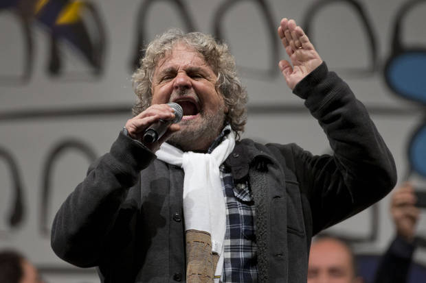 Italian comic-turned-political agitator Beppe Grillo, leader of the anti-establishment 5 Star Movement, delivers his speech during a final rally in view of the upcoming general elections, in Rome, Friday, Feb. 22, 2013. Grillo fills piazzas from Palermo deep in the south to Verona up north with Italians who seem to get some catharsis from his rants against the politicians who drove the country to the brink of financial ruin, the captains of industry whose alleged illegal shenanigans are tarnishing prized companies, and the bankers who aided and abetted both. (AP Photo/Andrew Medichini)