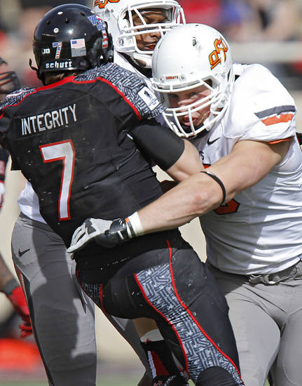 Oklahoma State Cowboys defensive end Cooper Bassett (80) hits Texas Tech Red Raiders quarterback Seth Doege (7) during the college football game between the Oklahoma State University Cowboys (OSU) and Texas Tech University Red Raiders (TTU) at Jones AT&T Stadium on Saturday, Nov. 12, 2011. in Lubbock, Texas.  Photo by Chris Landsberger, The Oklahoman  ORG XMIT: KOD