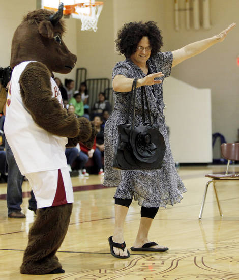 Centennial coach Scott Raper dances with the school mascot during an assembly to celebrate the Class 3A boys basketball championship. Photo by Nate Billings, The Oklahoman