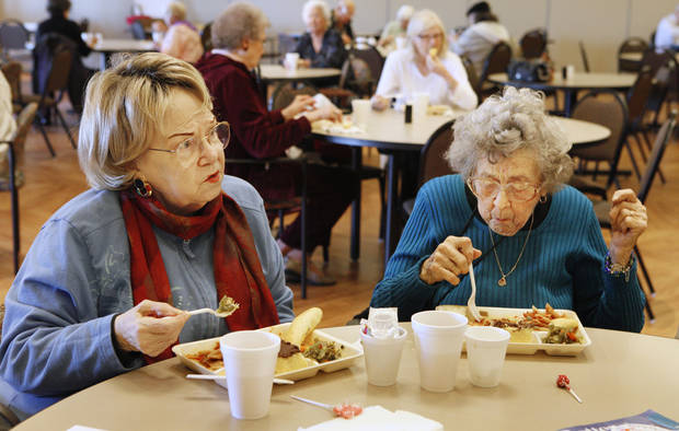 Verda Kenworthy and Mary Adams eat lunch at the Edmond Senior Center  in Mitch Park Tuesday. The meal program has been popular with Edmond seniors since it began. <strong>PAUL B. SOUTHERLAND - PAUL B. SOUTHERLAND</strong>